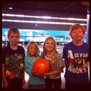 The kiddos bowling last summer at Stars and Strikes.